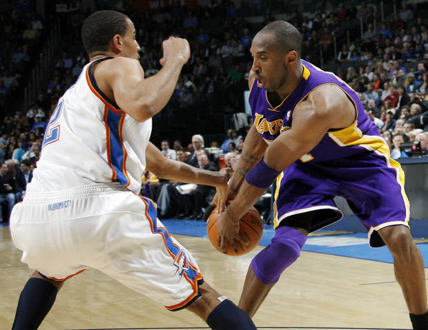 Thabo Sefolosha, left, tries to knock the ball away from Los Angeles&#039; Kobe Bryant during OKC&#039;s 91-75 win Friday. PHOTO BY NATE BILLINGS, THE OKLAHOMAN