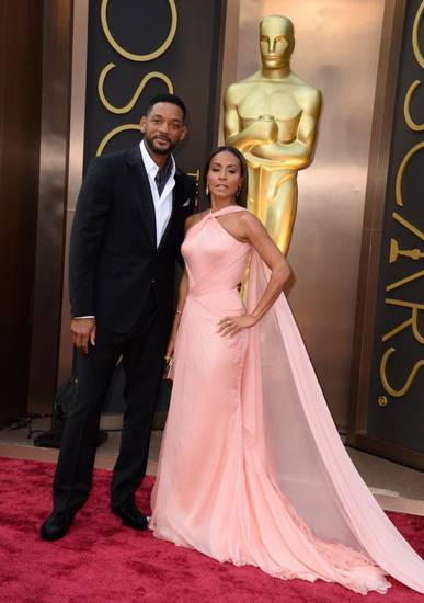 Will Smith, left, and Jada Pinkett Smith arrive at the Oscars. (AP)