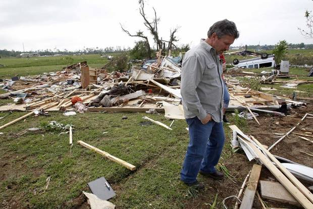 Jimmy Talley looks over the destroyed home of his brother, David, and sister-in-law, Katherine, on Tuesday, April 26, 2011, in Vilonia, Ark. Both David and Katherine Talley were killed when a tornado hit Vilonia. The couple had taken shelter in a metal utility building, but they died when the building was blown across a pond. (AP Photo/Mark Humphrey) ORG XMIT: ARMH106