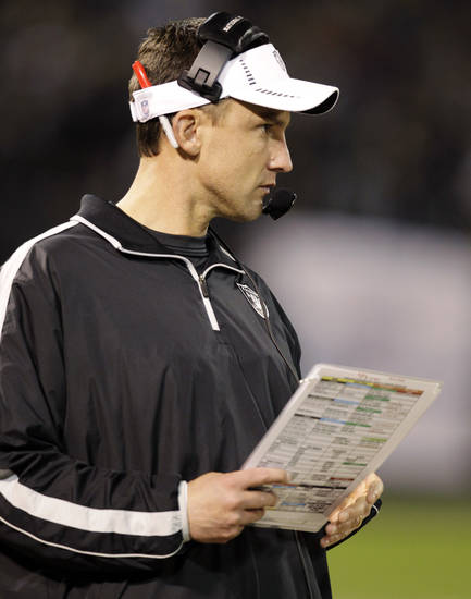 Oakland Raiders head coach Dennis Allen watches from the sidelines during the third quarter of an NFL football game against the Denver Broncos in Oakland, Calif., Thursday, Dec. 6, 2012. (AP Photo/Ben Margot)