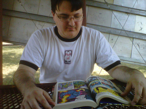 Nerdage's Matt Price reads Jack Kirby's Fourth World Omnibus Vol. 1 at a local park.  Photo by Rachel Price.