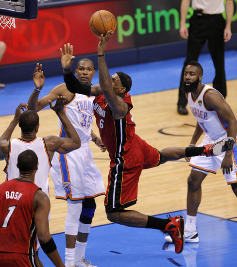 Miami's LeBron James (6) goes to the basket between Oklahoma's City's Kevin Durant (35) and James Harden (13) during Game 1 of the NBA Finals between the Oklahoma City Thunder and the Miami Heat at Chesapeake Energy Arena in Oklahoma City, Tuesday, June 12, 2012. Photo by Sarah Phipps, The Oklahoman