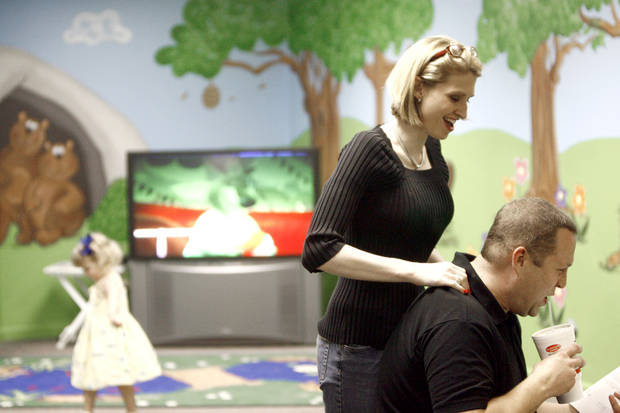 SECOND PLACE, WEB PHOTO: Tonya Ratcliff rubs her husband's shoulders as Elliott plays before the start of a Bible class at Quail Springs Church of Christ  in the evening, Wednesday, April 23, 2008, in Oklahoma City. BY SARAH PHIPPS, THE OKLAHOMAN
