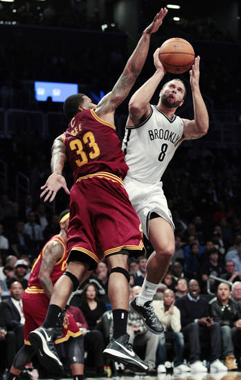 Brooklyn Nets' Deron Williams (8) shoots over Cleveland Cavaliers' Alonzo Gee (33) during the first half of an NBA basketball game, Tuesday, Nov. 13, 2012, in New York. (AP Photo/Frank Franklin II)