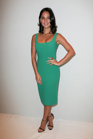 This image released by Starpix shows actress Olivia Munn attending the Michael Kors Spring 2013 Runway Show on Wednesday, Sept. 12, 2012 in New York. (AP Photo/Starpix, Andrew Toth) ORG XMIT: NYET923