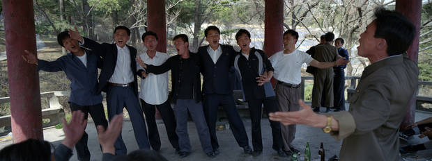 In this April 18, 2012 photo, North Korean men drink and sing inside a pagoda at a hilltop park overlooking Pyongyang. (AP Photo/David Guttenfelder)