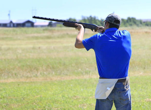 Altus High School's Joshua Hurst shoots a perfect 25 of 25 in the round Wednesday to help lead Altus to the team title in the Oklahoma Scholastic Shooting Sports Program state trap shooting championshp in El Reno.  Photo by Paul Hellstern, The Oklahoman