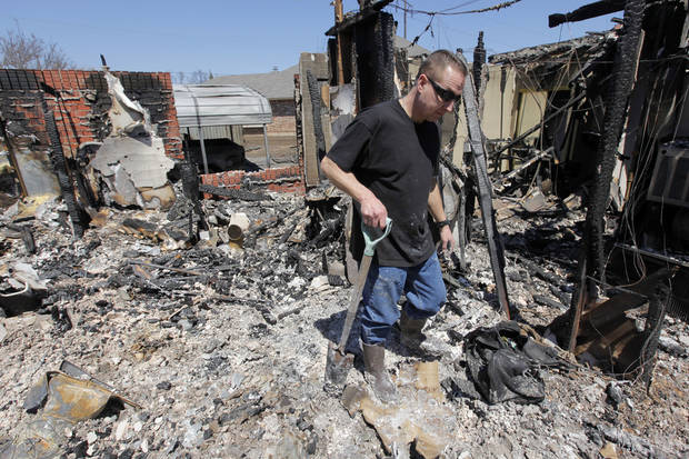 Todd Sewell walks through what is left of his home at 11533 Berkshire Ct. which was destroyed by fire, in Midwest City, Okla., Saturday, April 11, 2009. Wildfires struck the area on Thursday, April 9, 2009, destroying several homes. Photo by Nate Billings, The Oklahoman