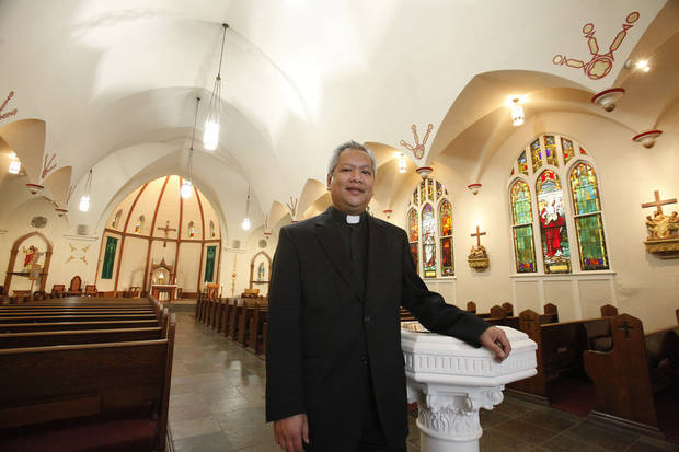 In this 2012 photo, the Rev. Roberto Quant, pastor of Sacred Heart Catholic Church, talks about Ash Wednesday services at his south Oklahoma City church.  <strong>David McDaniel - The Oklahoman</strong>