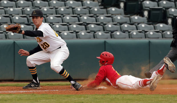 Dale&#039;s Gunnar Hathcock slides safely into third as Latta&#039;s Brady Johnson prepares to make a play during the Class A Fall baseball state championships between Dale and Latta at the Chickasaw Bricktown Ballpark in Oklahoma City,  Saturday, Oct. 6, 2012. Photo by Sarah Phipps, The Oklahoman