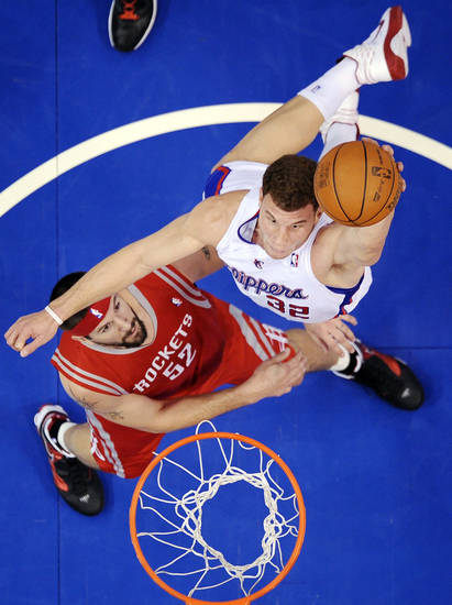 Los Angeles Clippers forward Blake Griffin, top, goes up for a dunk as Houston Rockets center Brad Miller defends during the first half of an NBA basketball game, Wednesday, Dec. 22, 2010, in Los Angeles. (AP Photo/Mark J. Terrill)