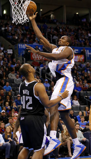 Oklahoma City's Serge Ibaka (9) goes to the basket over Sacramento's Chuck Hayes (42) during an NBA basketball game between the Oklahoma City Thunder and the Sacramento Kings at Chesapeake Energy Arena in Oklahoma City, Friday, Dec. 14, 2012. Photo by Bryan Terry, The Oklahoman