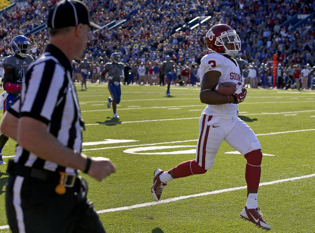OU's Sterling Shepard (3) scores a touchdown on a trick play during the college football game between the University of Oklahoma Sooners (OU) and the University of Kansas Jayhawks (KU) at Memorial Stadium in Lawrence, Kan., Saturday, Oct. 19, 2013. Oklahoma won 34-19. Photo by Bryan Terry, The Oklahoman