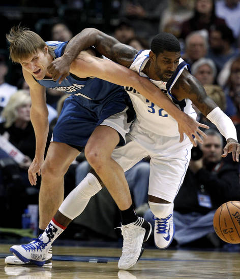 Minnesota Timberwolves' Andrei Kirilenko, left, of Russia, and Dallas Mavericks' O.J. Mayo (32) tangle up as they compete for a loose ball during the first half of an NBA basketball game, Monday, Nov. 12, 2012, in Dallas. (AP Photo/Tony Gutierrez)
