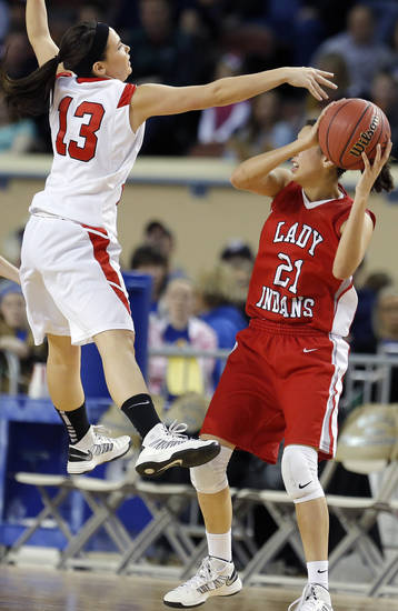Shattuck's Daniela Galindo looks to pass the ball as Erick's Kelsey Brinkley defends during the Class B Girls semifinal game of the state high school basketball tournament between Erick and Shattuck  at the State Fair Arena., Friday, March 1, 2013. Photo by Sarah Phipps, The Oklahoman