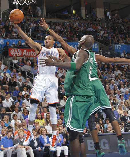 Oklahoma City Thunder point guard Russell Westbrook (0) drives past Boston Celtics power forward Kevin Garnett (5) during the NBA basketball game between the Oklahoma City Thunder and the Boston Celtics at the Chesapeake Energy Arena on Wednesday, Feb. 22, 2012 in Oklahoma City, Okla.  Photo by Chris Landsberger, The Oklahoman