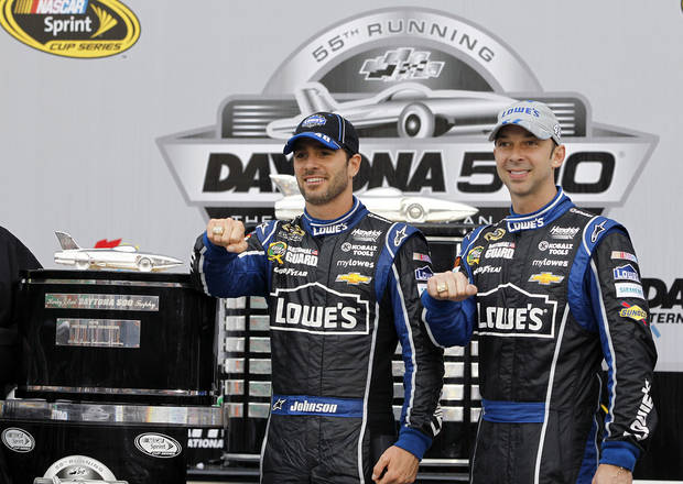FILE - In this Feb. 24, 2013 file photo, Jimmie Johnson, left,  and crew chief Chad Knaus wear Daytona 500 rings after winning the Daytona 500 NASCAR Sprint Cup Series auto race at Daytona International Speedway in Daytona Beach, Fla. It was important to Johnson to win a Daytona 500 with crew chief Chad Knaus there. (AP Photo/Terry Renna, File) ORG XMIT: NY155