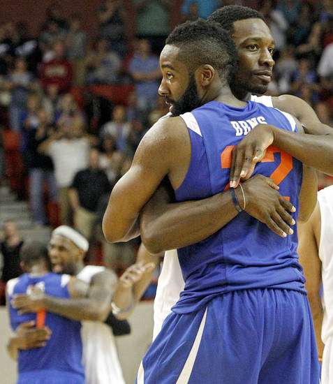 Jeff Green hugs former teammate James Harden after the US Fleet Tracking Basketball Invitational at the Cox Convention Center in Oklahoma City Sunday, Oct. 23, 2011. The White Team defeated the Blue Team 176-171. Photo by John Clanton, The Oklahoman