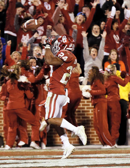 Oklahoma's Brennan Clay (24) reacts after rushing for the game-winning touchdown in overtime during the Bedlam college football game between the University of Oklahoma Sooners (OU) and the Oklahoma State University Cowboys (OSU) at Gaylord Family-Oklahoma Memorial Stadium in Norman, Okla., Saturday, Nov. 24, 2012. OU won, 51-48 in overtime. Photo by Nate Billings , The Oklahoman