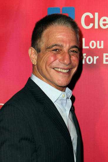 "FILE - In a Saturday, Feb. 18, 2012 file photo, actor Tony Danza arrives at the Keep Memory Alive 16th Annual ""Power of Love Gala"" honoring Muhammad Ali with his 70th birthday celebration, in Las Vegas. After starring in a reality TV show at a Philadelphia high school, Danza says he is disheartened by the reality of major district budget cuts this year. To help, Danza is hosting a fundraising talent show at Northeast High School in Philadelphia on Thursday evening, Feb. 23, 2012.   District officials are facing a $715 million deficit and have cut hundreds of positions and many programs. They must still cut nearly $39 million by June.    (AP Photo/Jeff Bottari, File) ORG XMIT: NY115"