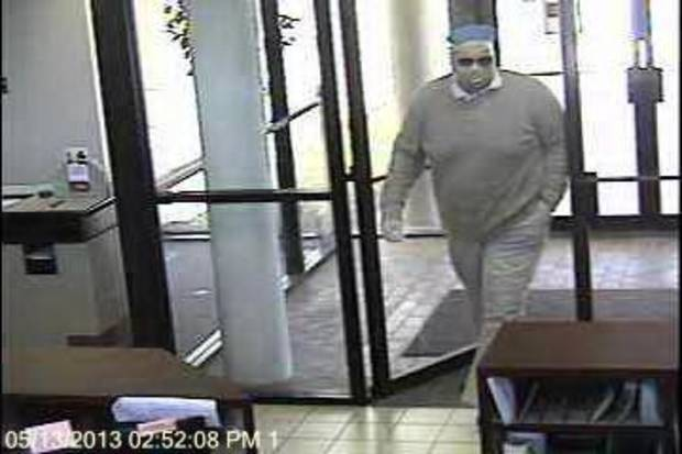 Surveillance photos of a robbery at Bank of Oklahoma, 11300 N May Avenue, on the afternoon of May 13. <strong></strong>