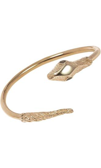 For those who follow the Chinese zodiac, the year of the snake begins Feb. 10. Some ways to incorporate the symbol of the year into your wardrobe, with no harm done to any living creature include this Jennifer Fisher brass snake cuff, $315 from Barneys.com. (Barneys.com via Los Angeles Times/MCT)