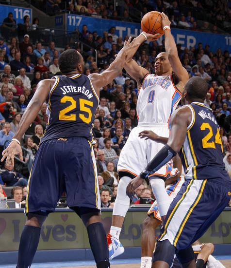 Oklahoma City's Russell Westbrook (0) puts up a shot between Utah's Al Jefferson (25) and Paul Millsap (24) during an NBA game between the Oklahoma City Thunder and the Utah Jazz at Chesapeake Energy Arena in Oklahoma CIty, Tuesday, Feb. 14, 2012. Photo by Bryan Terry, The Oklahoman