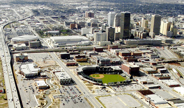 OKLAHOMA CITY / SKYLINE / AERIAL VIEW I-40: This is an aerial of downtown Oklahoma City.  Interstate 40 is shown at left running next to the Ford Center, at top left of photo.   The photo also showcases the SBC Bricktown Ballpark. Staff photo by Bill Waugh. Staff photo dated 03/07/2005.