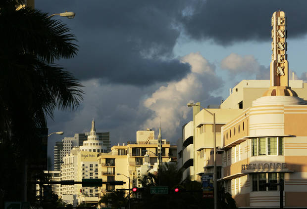 In this Jan. 7, 2008 file photo, Art deco designed buildings line Collins Avenue in Miami Beach, Fla. Modern day South Beach is still a vibrant monument to the art deco designs of the late 1920's and 30's. Walking around Ocean Drive and nearby streets to view the historic architecture is one of the cultural attractions of the city, among other interesting things to see and enjoy for free there. (AP Photo/Lynne Sladky, File)