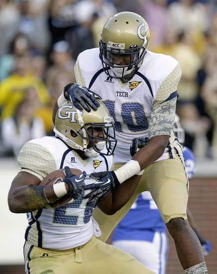 Georgia Tech running back David Sims, left, celebrates after scoring a touchdown with teammate Synjyn Days, right, in the first quarter of an NCAA college football game against Duke, Saturday, Nov. 17, 2012, in Atlanta. (AP Photo/David Goldman)
