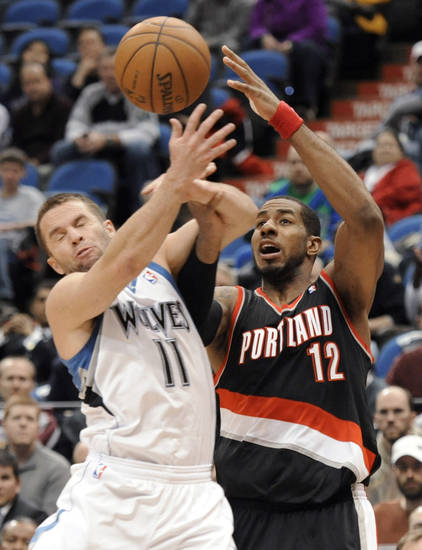Minnesota Timberwolves' J.J. Barea (11) attempts to steal the ball from Portland Trail Blazers' LaMarcus Aldridge (12) during the third quarter of an NBA basketball game  Monday, Feb. 4, 2013, in Minneapolis. The Trail Blazers won 100-98. (AP Photo/Hannah Foslien)