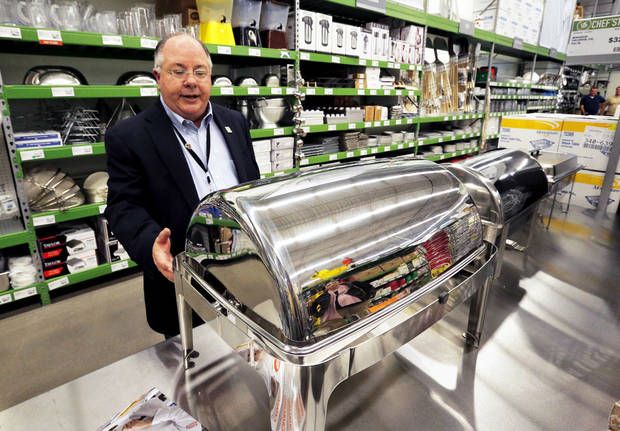 Sam Erwin, division president of US Foods, shows nonfood items for sale Tuesday at US Foods� Chef�store on Interstate 240 in Oklahoma City. Photos by Steve Sisney, The Oklahoman