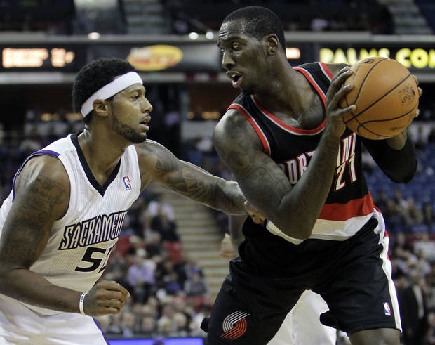 Sacramento Kings forward James Johnson, left, defends against Portland Trail Blazers forward J.J. Hickson during the first half of an NBA basketball game in Sacramento, Calif., Tuesday, Nov. 13, 2012. (AP Photo/Rich Pedroncelli)
