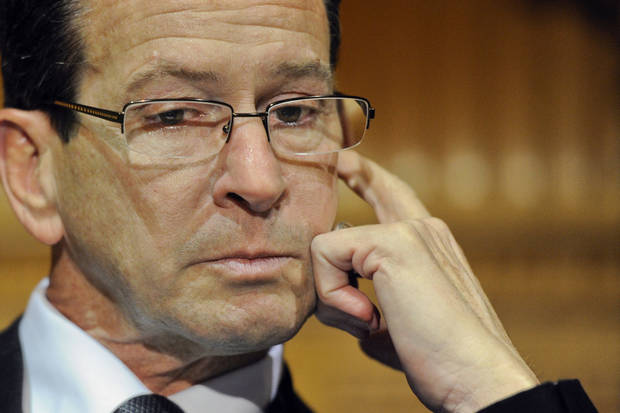 Connecticut Gov. Dannel P. Malloy wipes away a tear as he recalls how and why he decided to tell the families of the Sandy Hook Elementary School shooting that their loved ones were dead during a news conference at the Capitol in Hartford, Conn., Monday, Dec. 17, 2012. (AP Photo/Jessica Hill) ORG XMIT: CTJH101