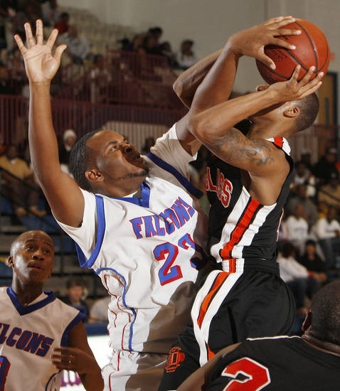 Emmanuel Cole of Millwood (23) tries to block the shot of DeAngelo Smith (4) of Douglass during a boys high school basketball game between Douglass and Millwood at the Millwood Field House in Oklahoma City, Friday, Jan. 13, 2012. Photo by Nate Billings, The Oklahoman