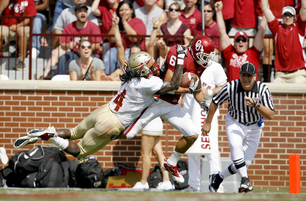 OU's Cameron Kenney gets past Florida State's Terrance Parks for a touchdown during the first half of the college football game between the University of Oklahoma Sooners (OU) and Florida State University Seminoles (FSU) at the Gaylord Family-Oklahoma Memorial Stadium on Saturday, Sept. 11, 2010, in Norman, Okla.   Photo by Bryan Terry, The Oklahoman