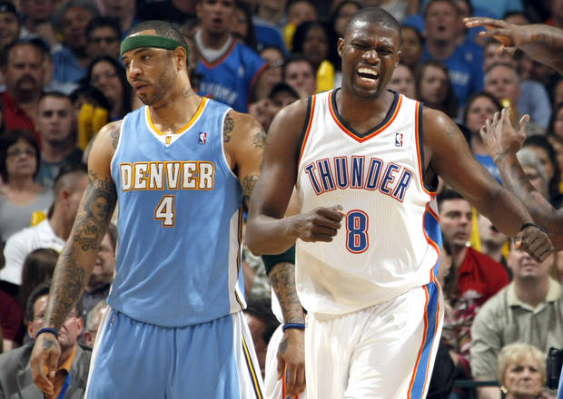 Oklahoma City's Nazr Mohammed (8) celebrates in front of Denver's Kenyon Martin (4) during the NBA basketball game between the Oklahoma City Thunder and the Denver Nuggets, Friday, April 8, 2011, at the Oklahoma City Arena.. Photo by Sarah Phipps, The Oklahoman