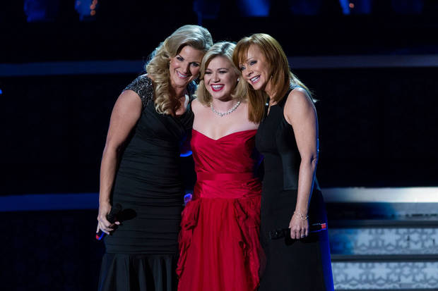 From left, Trisha Yearwood, Kelly Clarkson and Reba McEntire appear on Clarkson's recent NBC Christmas special.
