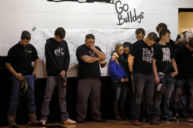 Students and residents of Cement, Okla., pause during a moment of silence for Seth Martin, 15, before the start of a girls basketball game in Cement, Okla., Wednesday, January 30, 2014. Seth Martin, 15, collapsed during Tuesday's game game and later died at the hospital. Photo by Bryan Terry, The Oklahoman