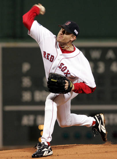 FILE - In this Oct. 24, 2004, file photo, Boston Red Sox starting pitcher Curt Schilling throws to the plate against the St. Louis Cardinals during the first inning of Game 2 of baseball's World Series in Boston. Schilling, whose video game company underwent a spectacular collapse into bankruptcy last year, is selling the blood-stained sock he wore during that game. (AP Photo/Elise Amendola, File)
