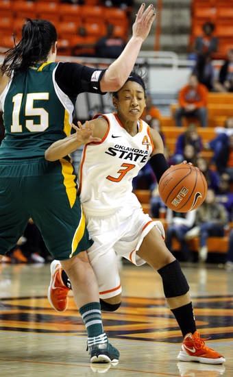 Oklahoma State's Tiffany Bias (3) gets around Vermont's Annie Wheeler (15) during the women's college basketball game between Oklahoma State University and Vermont at Gallagher-Iba Arena in Stillwater, Okla., Sunday,Dec. 16, 2012. Photo by Sarah Phipps, The Oklahoman