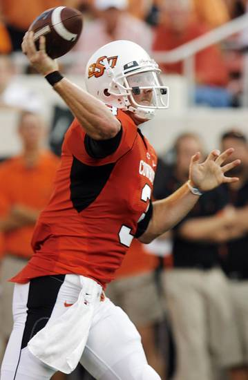 OSU quarterback Brandon Weeden (3) passes the ball in the first quarter during the college football game between the University of Tulsa (TU) and Oklahoma State University (OSU) at Boone Pickens Stadium in Stillwater, Oklahoma, Saturday, September 18, 2010. Photo by Nate Billings, The Oklahoman