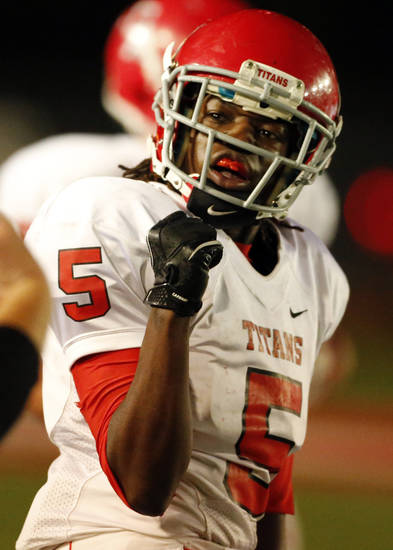 Carl Albert player Bryan Williams celebrates a stop against the Del City Eagles in Class 5A, first round, playoff action in high school football on Friday, Nov. 9, 2012 in Del City, Okla.   Photo by Steve Sisney, The Oklahoman