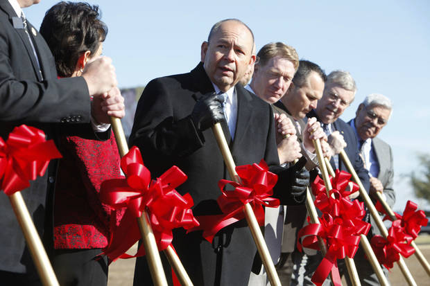 Chickasaw Nation officials man shovels for a ceremonial groundbreaking Thursday for a  medical clinic to be built adjacent to the Riverwind Casino. PHOTO BY PAUL HELLSTERN, THE OKLAHOMAN <strong>PAUL HELLSTERN</strong>
