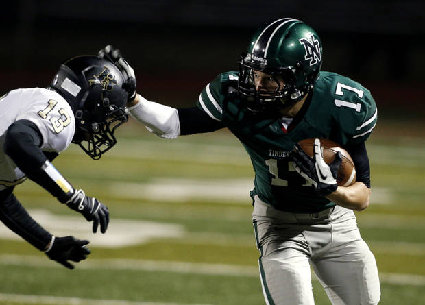 Norman North Timberwolves quarterback Channing Meyer pushes Broken Arrow's Gabe Johnson on a running play in class 6A football on Friday, Nov. 16, 2012 in Norman, Okla.  Photo by Steve Sisney, The Oklahoman