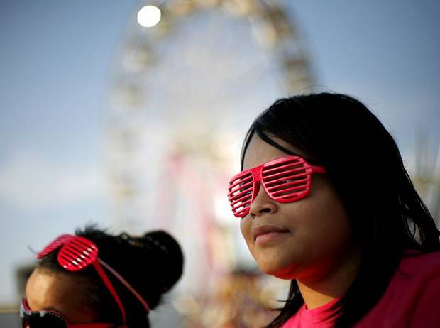 Waiting in line for a ride, Kayla Melher (right) and her sister Olivia, wear glasses they bought on the midway during the 2009 Oklahoma State Fair at State Fair Park in Oklahoma City on Sunday, Sept. 20, 2009.  By John Clanton, The Oklahoman ORG XMIT: KOD