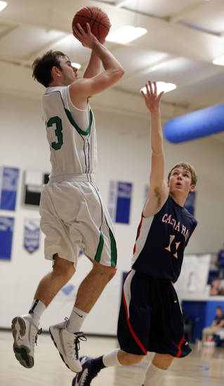 McGuinness' Stephen Amalong shoots over Cascia Hall's Adam Outlaw during boys basketball game between Bishop McGuinness and Cascia Hall at the Hoops 4 Hope  basketball tournament at Mount St. Mary High School in Oklahoma City,  Friday,Nov. 8, 2013. Photo by Sarah Phipps, The Oklahoman