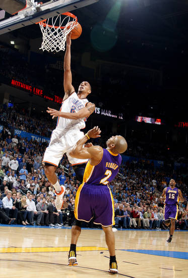 Oklahoma City's Thabo Sefolosha (2) shoots over Lakers' Derek Fisher (2)during the NBA basketball game between the Oklahoma City Thunder and the Los Angeles Lakers, Sunday, Feb. 27, 2011, at the Oklahoma City Arena.Photo by Sarah Phipps, The Oklahoman