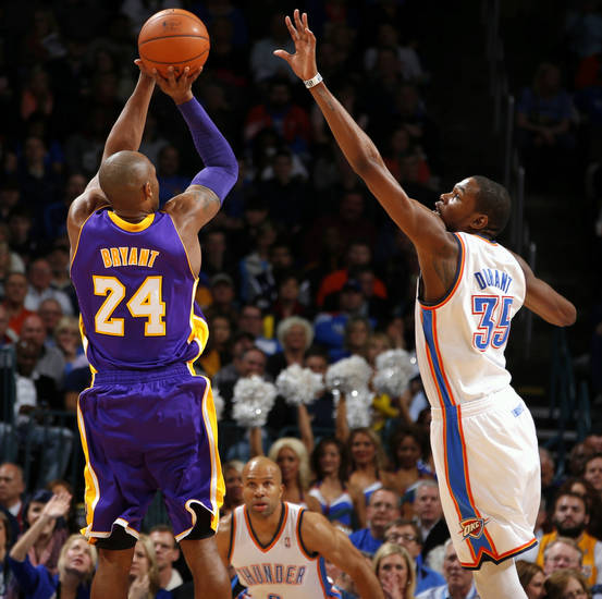 Los Angeles' Kobe Bryant shoots the ball over Oklahoma City's Kevin Durant during an NBA basketball game between the Oklahoma City Thunder and the Los Angeles Lakers at Chesapeake Energy Arena in Oklahoma City, Tuesday, March 5, 2013. Photo by Bryan Terry, The Oklahoman