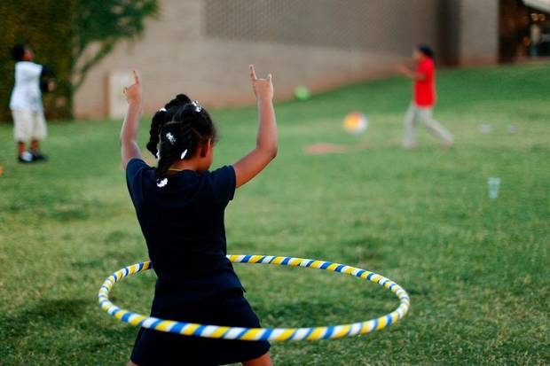 Naomi Williams, 7, hula hoops during Jazz on the Lawn at the Ralph Ellison Library on Tuesday, September 4, 2012. Photo by Bryan Terry, The Oklahoman